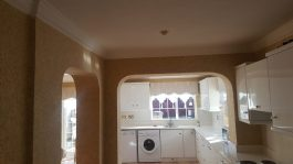 gold kitchen and arch